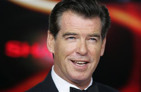 Pierce Brosnan arrives at the red-carpet for the 'Goldene Kamera' award given by a popular German television magazine in Berlin February 1, 2007 file photo. Brosnan is in final negotiations to join Meryl Streep in the movie version of the popular ABBA musical ''Mamma Mia!'' REUTERS/Hannibal Hanschke