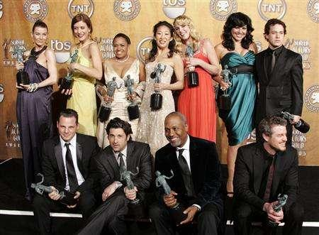 ''Grey's Anatomy'' cast, (L-R top row) Ellen Pompeo, Kate Walsh, Chandra Wilson, Sandra Oh, Katherine Hiegl, Sara Ramirez, T.R. Knight, (L-R bottom row), Justin Chambers, Patrick Dempsey, James Pickens, Jr. and Eric Dane pose with their awards backstage at the 13th Annual Screen Actors Guild Awards in Los Angeles January 28, 2007. REUTERS/Lucy Nicholson