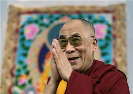 Tibet's spiritual leader, the Dalai Lama, gestures during a public meeting in Mumbai January 31, 2007. An India-based human rights watchdog has denounced China for human rights abuses in Tibet last year and predicted that religious repression would get worse in 2007. REUTERS/Adeel Halim