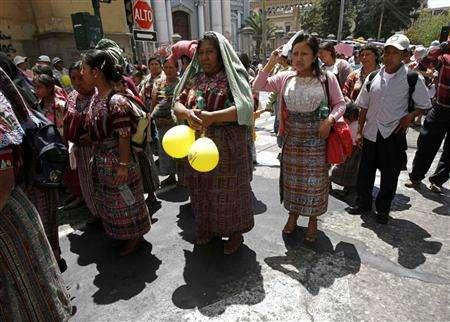 Mayan women take part in an International Women's Day march in Guatemala City March 8, 2007. Mayan leaders will spiritually ''cleanse'' ancient ruins in Guatemala after a visit by U.S. President George W. Bush, unpopular here because of foreign policies going back to Central America's civil wars. REUTERS/Daniel LeClair