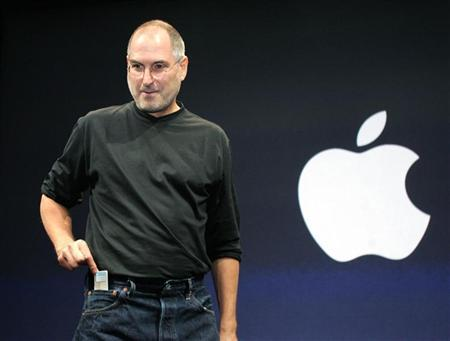 Apple CEO Steve Jobs pulls the iPod nano out of his jeans pocket after introducing it at an event in San Francisco, California in this September 7, 2005 file photo. European Union consumer chief Meglena Kuneva has hit out at Apple Inc.'s <AAPL.O> bundling of its popular iPod music players and its iTunes online music store, according to German weekly magazine Focus. REUTERS/Lou Dematteis