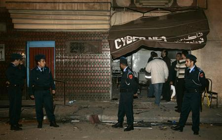 Members of a bomb squad inspect the scene of an explosion at an Internet cafe in Casablanca March 12, 2007. REUTERS/Rafael Marchante