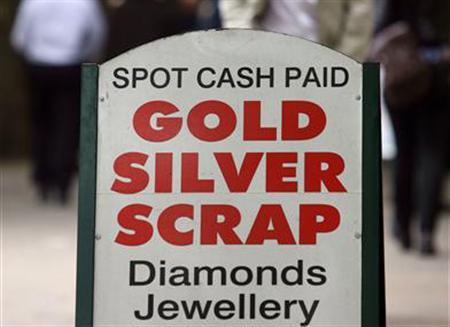 A sign advertising the purchase of scrap precious metals inLondon, May 16, 2006. Thefts of metal are not a new phenomenon. The lead roofs of English churches and monasteries were plundered by Henry VIII in the 16th Century and are still a popular target for thieves. REUTERS/Stephen Hird