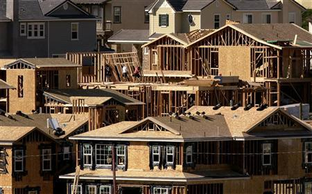 Construction workers put up second story framing as they build homes in Carlsbad, California November 17, 2005. The pace of U.S. home construction rose 9 percent in February, beating analysts' predictions and running against dismal news in the subprime home financing sector, a government report showed on Tuesday. REUTERS/Mike Blake