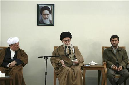 Former Iranian President Akbar Hashemi Rafsanjani (L) and President Mahmoud Ahmadinejad (R) listen as Iran's Supreme Leader Ayatollah Ali Khamenei speaks to members of the Expediency Council in Tehran March 12, 2007. Khamenei warned on Wednesday Iran would hit back with everything it has if attacked over its disputed nuclear program, according to provincial television monitored by the BBC. REUTERS/Stringer