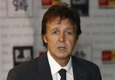Paul McCartney poses for the media before a signing session in London November 22, 2006. Starbucks Corp. said on Wednesday former Beatle Paul McCartney would be the first musician to release an album on the coffee shop chain's new Hear Music record label. REUTERS/Stephen Hird