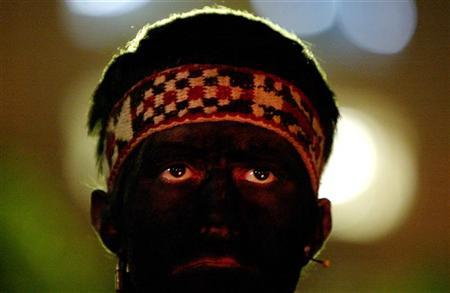 A man dressed as an indigenous Chilean Mapuche listens during a rally in front of La Moneda Presidential Palace in Santiago, Chile May 10, 2006. Chileans are rediscovering the ancient herbal remedies of the Mapuche indigenous tribe, including a sexual energizer touted as a natural Viagra and other inexpensive alternative medicines. REUTERS/Ivan Alvarado
