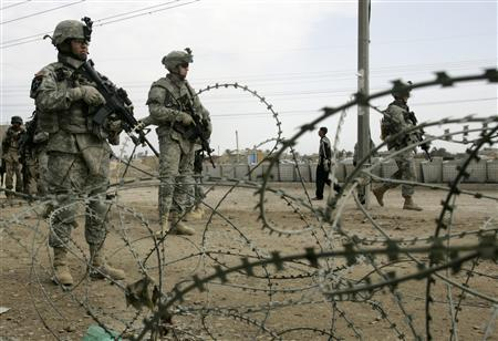 U.S. soldiers secure the area at the site of a local council during their session with U.S. forces to discuss local affairs in Baghdad's northwest Sunni neighbourhood of Ghazaliya March 27, 2007. REUTERS/Fabrizio Bensch