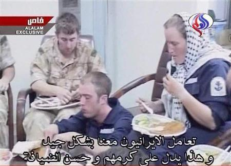 Some of the 15 captured British sailors and marines are seen eating on Iranian television March 28, 2007. REUTERS/Al Alam Television