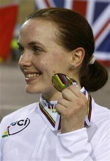 Britain's Victoria Pendleton shows off her medal after winning the gold in the Women's Keirin at the track cycling world championships in Palma de Mallorca, April 1, 2007. REUTERS/Andrea Comas