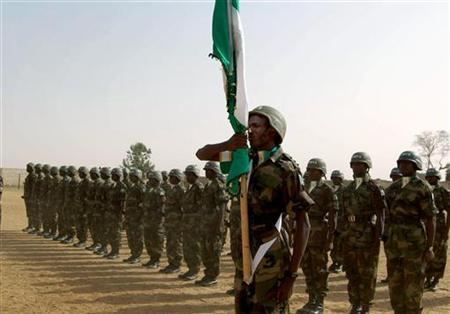 African Union (AU) soldiers parade at their base in el-Geneina in Sudan's Western Darfur state, March 16, 2006. Unidentified gunmen killed five African Union peacekeepers in the Darfur region of western Sudan, the deadliest single attack against the force since late 2004, an AU spokesman said on Monday. REUTERS/Opheera Mcdoom