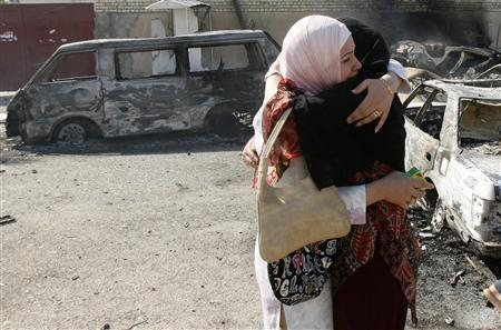Women embrace after a suicide bomb attack in Baghdad, April 5, 2007. In the volatile Iraqi city of Ramadi on Friday, a truck bomb exploded killing at least 15 people and releasing chlorine gas into the air, police and security sources said. REUTERS/Mahmoud Raouf Mahmoud