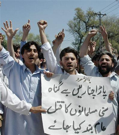Protesters hold a placard as they chant slogans against the clashes between Sunni and shi'ite Muslims in Parachinar during a protest in Peshawar April 7, 2007. The placard reads ''Killing of innocent people in Parachinar be stopped.'' REUTERS/Ali Imam