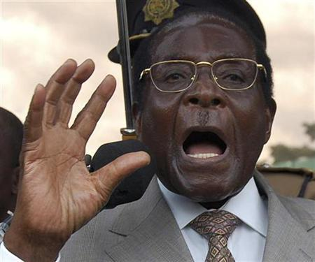 In this file picture, Zimbabwe's President Robert Mugabe talks to his supporters in Harare March 30, 2007. Zimbabwe's Catholic bishops have accused President Robert Mugabe and his officials of running a bad and corrupt government and called for radical political reforms to avoid a revolt in the southern African state. REUTERS/Phimon Bulawayo