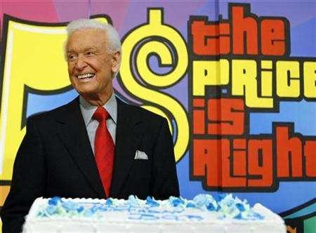 Bob Barker, host of the television game show 'The Price is Right', smiles near his birthday cake at CBS Studios in Los Angeles December 12, 2006. ''Entertainment Tonight'' co-host Mark Steines, actor George Hamilton and Las Vegas' ''The Price Is Right'' stage show host Todd Newton are still in the running to succeed Barker as host of CBS' venerable game show ''The Price Is Right.''REUTERS/Mario Anzuoni
