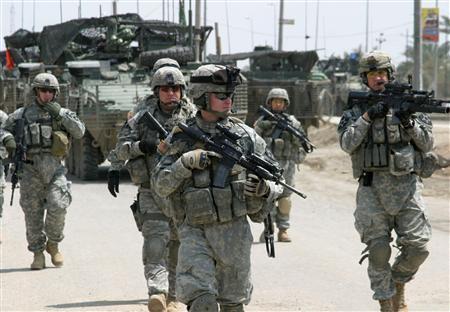 U.S. soldiers patrol a road in Diwaniya, south of Baghdad, April 15, 2007. REUTERS/Imad al-Khozai