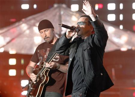 Irish rock band U2's front man Bono (R) and guitarist The Edge perform during the band's first of three Sydney concerts in this November 10, 2006 file photo. Bono and The Edge are about to write the music and lyrics for a Broadway musical about Spider-man. REUTERS/Tim Wimborne
