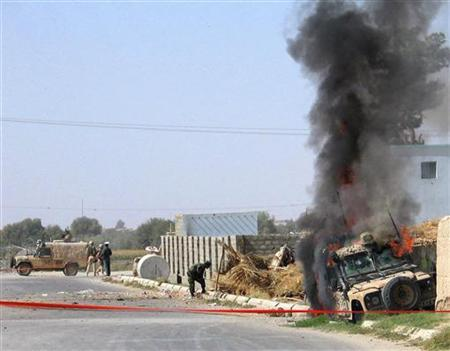 British soldiers with the NATO force try to secure the site of a suicide attack in Afghanistan's southern Helmand province in this file picture. Two NATO soldiers have been killed in separate blasts in southern Afghanistan, the alliance said on Friday. REUTERS/Abdul Qodous