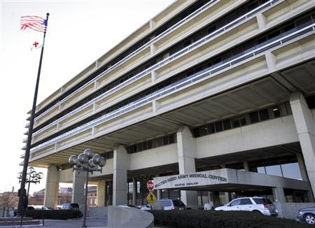 A view of the main entrance to Walter Reed Army Medical Center in Washington in this February 9, 2007 file photo. The government has been on the defensive about veterans' medical care after a probe found shoddy living conditions of recovering wounded at Walter Reed Army Medical Center, considered the jewel in the military's health care system. REUTERS/Yuri Gripas/Files