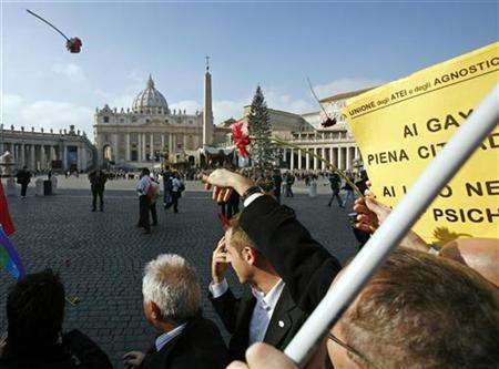 Members of gay and lesbian associations throw flowers as they demonstrate on St. Peter's square at the Vatican, January 13, 2007. The Vatican's second-highest ranking doctrinal official on Monday forcefully branded homosexual marriage an evil and denounced abortion and euthanasia as forms of ''terrorism with a human face''. REUTERS/Dario Pignatelli