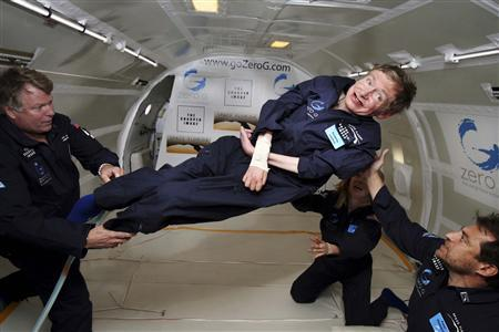 British physicist Stephen Hawking is assisted as he floats during a ZERO-G flight aboard a modified Boeing 727 after taking off from the Kennedy Space Center in Cape Canaveral, April 26, 2007. REUTERS/Zero-Gravity Corporation/Handout.