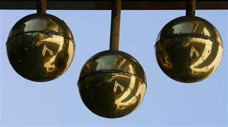 Golden balls hang outside a pawnbrokers in Victoria in London in this April 19, 2007 file photo. For people who need cash but are in debt and not sure property prices will support another loan, an ancient solution may be making a comeback: the pawn shop. To match feature REUTERS/Stephen Hird/Files