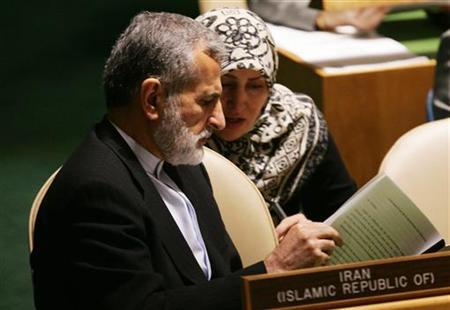 Iranian Foreign Minister Dr. Kamal Kharrazi looks over his remarks with an aide as he prepares for his address to the 2005 Review Conference of the Parties to the Treaty on the Non-Proliferation of Nuclear Weapons in the General Assembly hall at United Nations headquarters in New York, May 3, 2005. REUTERS/Mike Segar