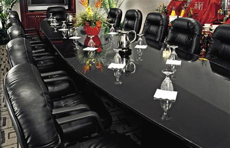 An undated file photo of a boardroom. Corporate boardrooms are slowly becoming a somewhat friendlier place for gay executives, but as John Browne's sudden exit from the top job at oil major BP Plc showed when his sexuality became public fodder, there are still challenges to overcome. REUTERS/PRNewsFoto
