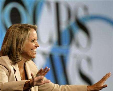 News anchor Katie Couric gestures during a CBS News panel at the ''Television Critics Association'' summer 2006 media tour in Pasadena, California, in this July 16, 2006 file photo. The newly appointed senior vp of CBS News says it's frustrating that the network's low-rated evening newscast with Couric isn't doing better, but he believes the program is finally on the right track. REUTERS/Mario Anzuoni