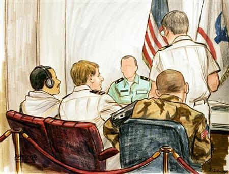 In this courtroom illustration, Salim Ahmed Hamdan (L) appears with appointed council Lieutenant Commander Charles Swift (2nd-L) during a preliminary hearing held on the Naval Base at Guantanamo Naval Base August 24, 2004. The Pentagon on Thursday charged Hamdan, the Guantanamo prisoner whose lawsuit derailed the Bush administration's original terror trial plan, with conspiracy and material support for terrorism. REUTERS/POOL/Illustration by Art Lein