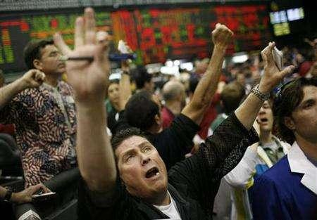 Traders call out trades on the floor of the Chicago Mercantile Exchange, April 25, 2007. Chicago Mercantile Exchange Holdings Inc battling the IntercontinentalExchange Inc. for control of CBOT Holdings Inc., raised its takeover offer for the Chicago Board of Trade's parent by 16 percent, the CME and CBOT said Friday. REUTERS/John Gress
