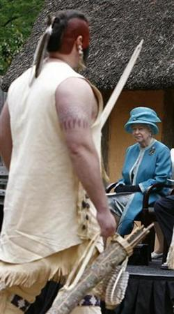 Britain's Queen Elizabeth II watches on as an actor portraying an American Indian takes part in a performance during her visit to the historical Jamestown settlement near Williamsburg, Virginia, May 4, 2007. For most U.S. citizens the 400th anniversary of the first permanent English settlement in America is a time to celebrate pioneers who crossed the ocean in sailing ships and braved hardships to forge a nation. But for American Indians whose ancestors lived in America when the English adventurers slogged ashore on Jamestown Peninsula in what is now Virginia, it is at once a reminder of their long struggle to overcome persecution and prejudice and a chance to reintroduce themselves to the world. REUTERS/Jason Reed