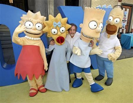 Matt Groening (C), creator and executive producer of the Fox television network animated television series ''The Simpsons'', poses with characters (L-R) Lisa, Maggie, Bart and Homer Simpson as he arrives for a block party on the Fox studio lot celebrating the series 350th episode in Los Angeles, in this April 25, 2005 fle photo. Groening remembers the moment he realized that ''The Simpsons'' -- the Fox show he created, executive produces and has nurtured as his favorite child for 18 seasons -- had grown to become a genuine colossus of popular culture. REUTERS/Fred Prouser