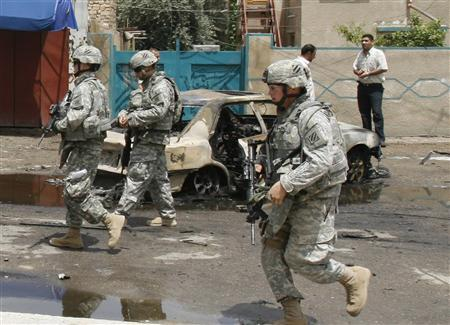 U.S. soldiers secure the scene of a bomb attack in Baghdad May 14, 2007. REUTERS/Mahmoud Raouf Mahmoud