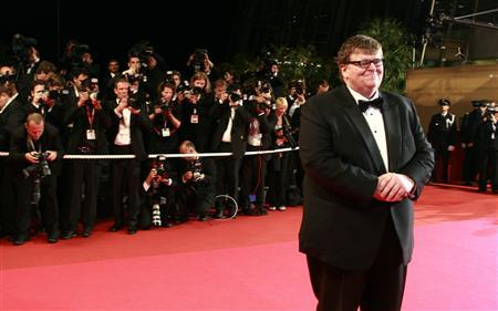 Michael Moore arrives for a gala screening of his film ''Sicko'' at the 60th Cannes Film Festival May 19, 2007. REUTERS/Eric Gaillard
