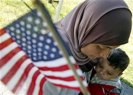 File photo of Karima Mezry of Morocco hugging her son Soufiane after taking the oath of citizenship to become an American citizen during a U.S. Citizenship and Immigration Services ceremony in Mount Vernon, Virginia, May 21, Opposition to a compromise immigration overhaul grew on Monday, with labor unions and Hispanic groups saying the deal brokered by leading U.S. senators and the White House was bad for workers, families and employers.2007. REUTERS/Jim Young