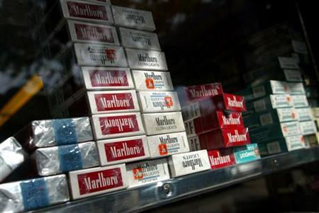 Packs of cigarettes are stacked inside a supermarket in New York September 21, 2004. The Food and Drug Administration should be given the power to regulate tobacco products and cigarette taxes should be hiked as part of a government campaign to reduce smoking, an expert panel recommended on Thursday. REUTERS/Shannon Stapleton
