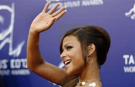 Christina Milian waves as she arrives at the 2007 Taurus World Stunt Awards at Paramount Studios in Los Angeles May 20, 2007. The CW has picked up the comedy pilot ''Eight Days a Week'' to series with a 12-episode midseason order. The comedy, whose ensemble cast includes Milian and Mario Lopez, revolves around four twentysomethings who work under the top movers and shakers in New York. REUTERS/Mario Anzuoni