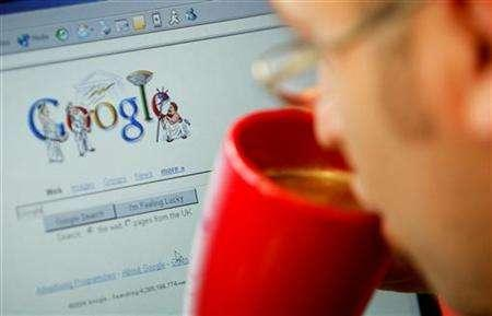 An internet surfer views the Google home page at a cafe in London, August 13, 2004. Google opened a research and development centre in Tel Aviv, the Web search leader's second such centre to open in Israel within a year. REUTERS/Stephen Hird