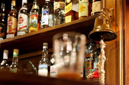 A traditional ''last orders'' bell is seen behind a bar in Victoria, central London, November 23, 2005. Dutch students have developed powdered alcohol which they say can be sold legally to minors. REUTERS/Toby Melville