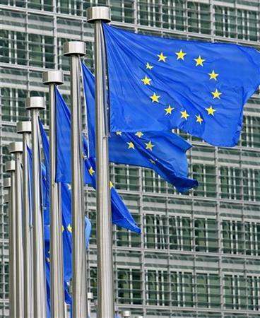 European Union flags are seen outside the European Commission headquarters during the EU summit in Brussels June 17, 2005. Leaders of the European Union appealed to Britain and Poland on Tuesday to show political courage and compromise on a new treaty to reform the bloc's creaking institutions amid mounting Polish threats of a veto. REUTERS/Yves Herman