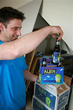 Rich Weber, the owner of the Sierra Blanca Brewery looks at a bottle of Roswell Amber Alien Ale, May 18, 2007. Weber is one of a growing number of brewers in the United States moving beyond traditional U.S. beers. REUTERS/Nick Carey