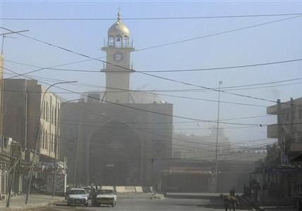 Dust obscures the Golden Mosque Shi'ite shrine after insurgents blew up two minarets in Samarra, north of Baghdad, June 13, 2007. REUTERS/Nuhad Hussin
