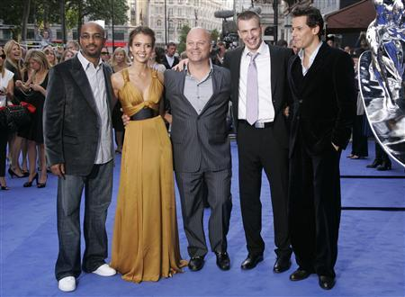 Director Tim Story, Actors (L-R) Jessica Alba, Michael Chiklis, Chris Evans and Loan Gruffudd arrive for the world premiere of ''Fantastic Four: Rise of the Silver Surfer'' at the VUE cinema in Leicester Square in London June 12, 2007. A projectionist at a Memphis theater chain has lost his job after writing an unauthorized early review of the movie for the Web site Ain't It Cool News. REUTERS/Luke MacGregor