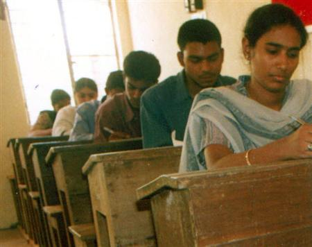 Students take an examination in the southern Indian state of Andhra Pradesh in a file photo. A 73-year-old Indian farmer who vowed not to marry before passing his high school exams has failed to get through for the 38th time. REUTERS/File