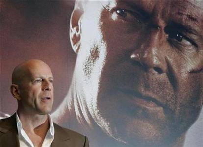 Actor Bruce Willis poses during a news conference for the movie ''Die Hard 4.0'' in Tokyo, June 12, 2007. REUTERS/Michael Caronna
