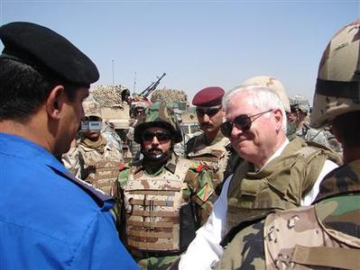 U.S. Defense Secretary Robert Gates meets members of the Iraqi Army and Iraqi police during a visit to a joint security station in Baghdad, June 16, 2007. Gates told Iraqi leaders on Saturday that Washington was disappointed with their efforts to reconcile warring factions. REUTERS/Andrew Gray