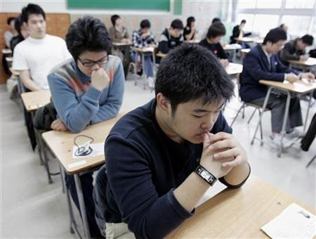 Students wait before they take college entrance exams in Seoul, in this file photo from November 16, 2006. A 16-year-old Berlin student was so worried he would have to repeat a year at school because of poor marks he convinced two friends to storm his class and steal the report cards with his bad grades. REUTERS/Lee Jae-Won
