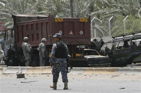 U.S. and Iraqi military forces secure the site of bomb attack in Baghdad's Saidiya district, June 18, 2007. REUTERS/Ali Jasim