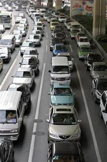 Vehicles are seen on a street in Shanghai May 25, 2007. REUTERS/Aly Song
